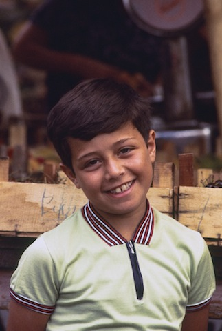 Small Italian boy at Rome's flea market, 1970